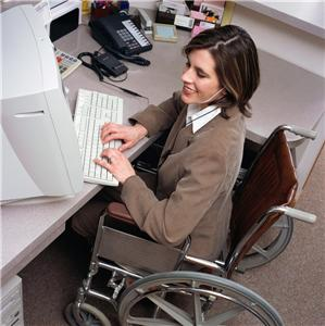 Person in wheelchair using computer