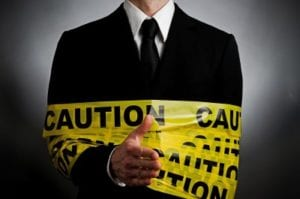 Business person wrapped in caution tape