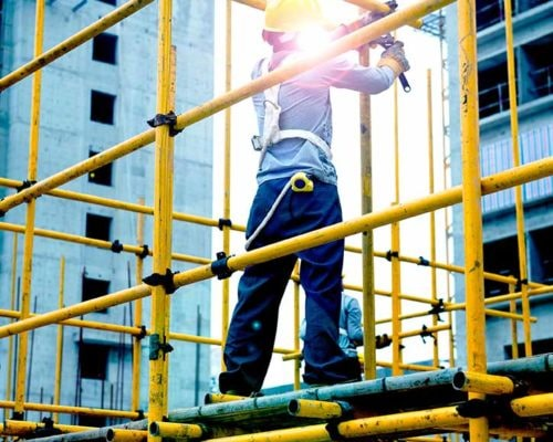 Construction worker working on scaffolding