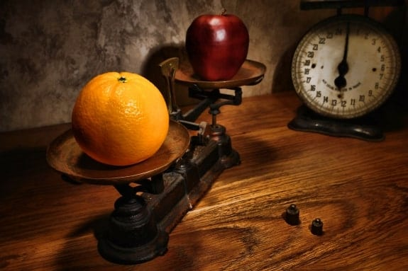 Scale weighing apples and oranges