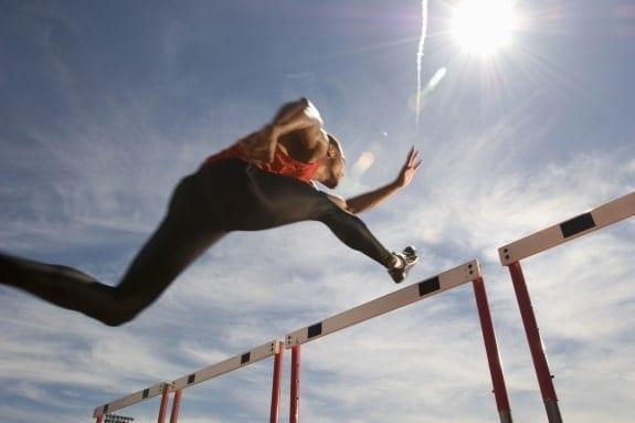 Runner jumping hurdles