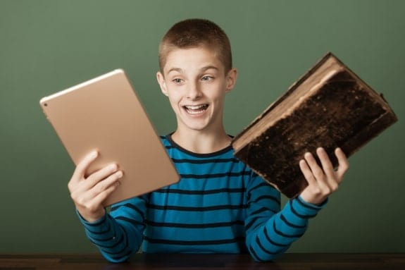 Boy with book and ipad