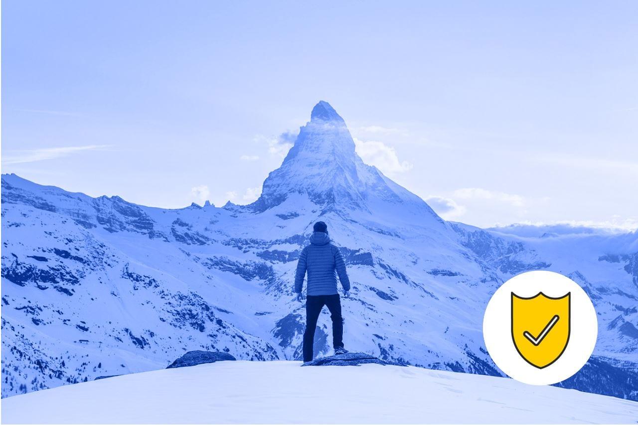 Man climbing a mountain showing grit