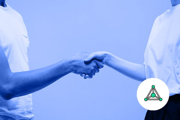 Two people shake hands with the Talegent Integration logo in the corner