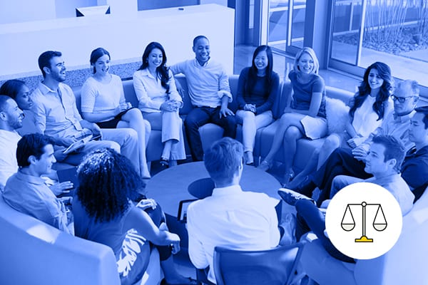 A circle of men and women in business clothes sitting and talking to each other